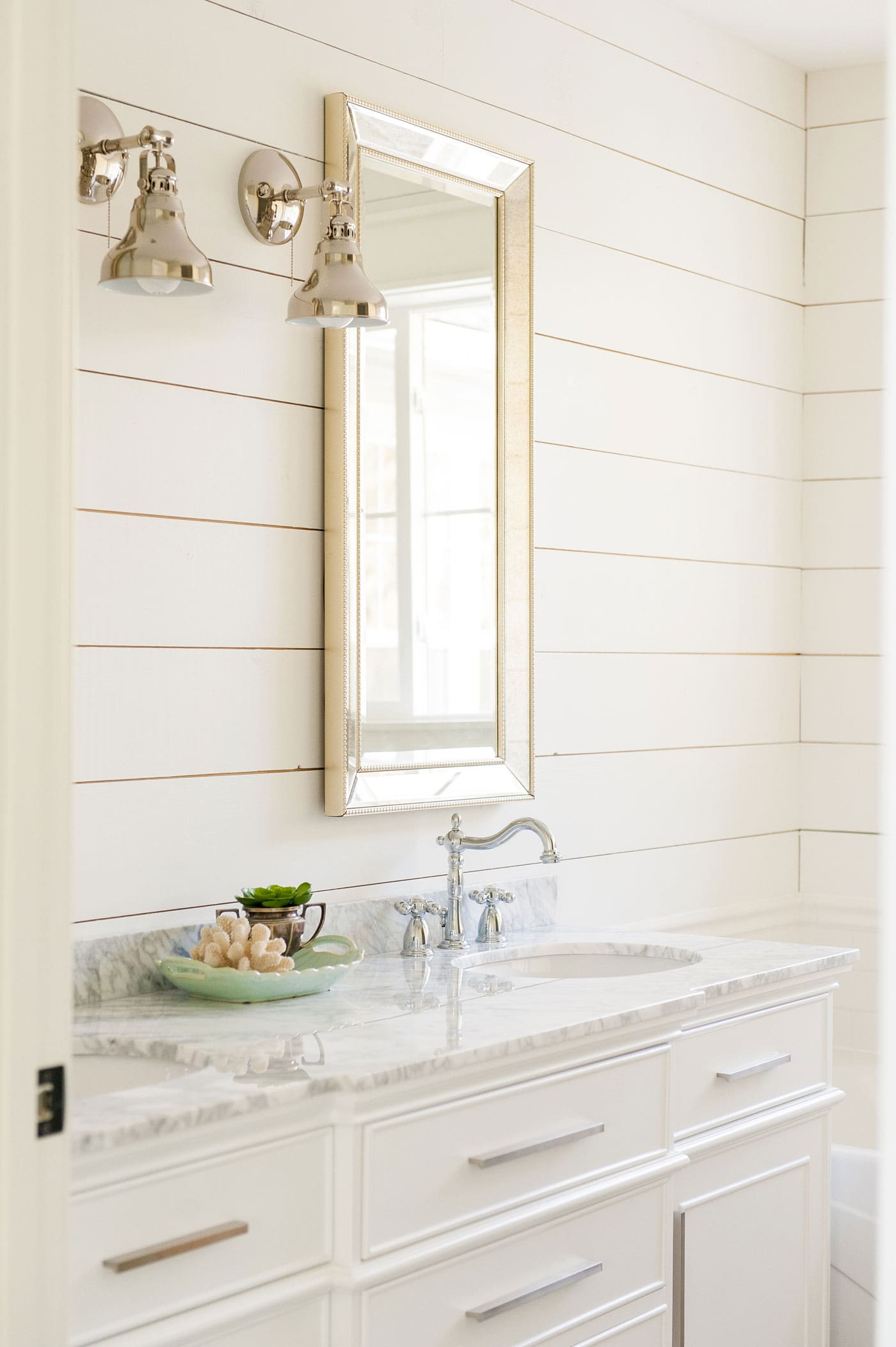 shiplap walls in a bathroom painted alabaster white