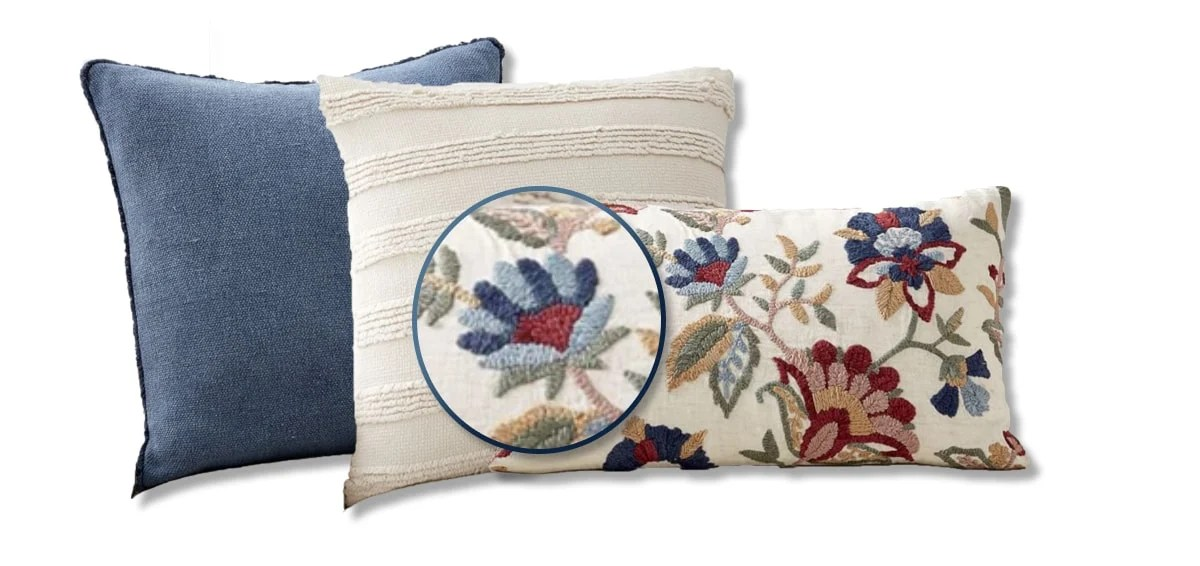 close up of the floral pattern on the pillow showing the shade of blue and cream