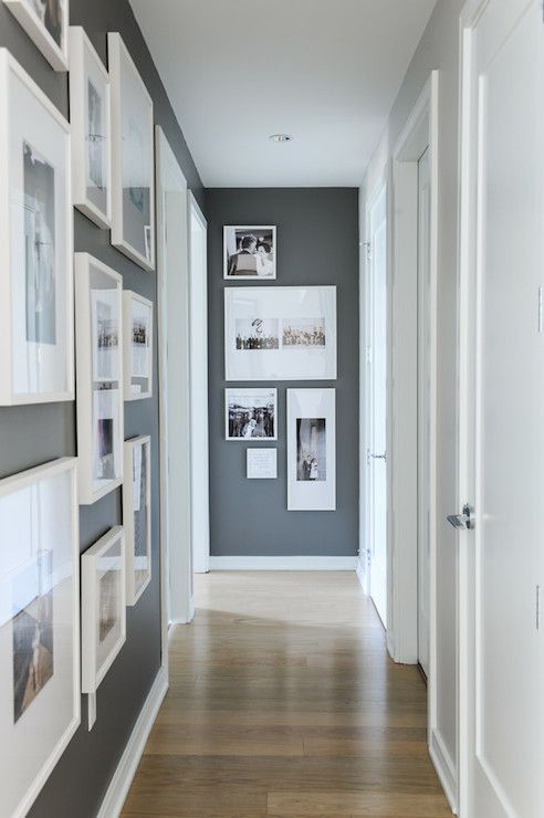 Hallway with Kendall Charcoal walls and bright white trim and photo frames