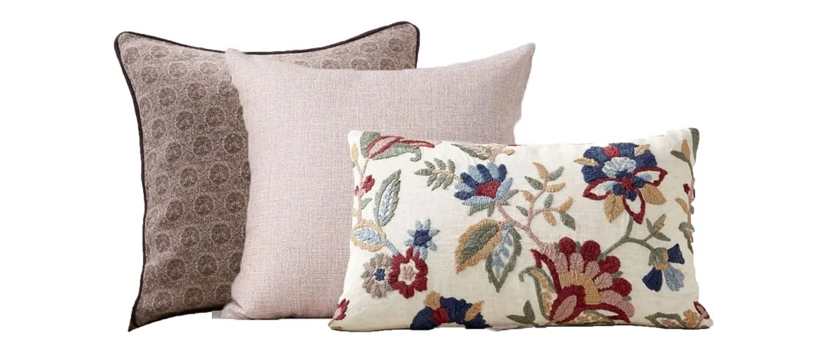 the same floral pillow paired with pink toned pillows