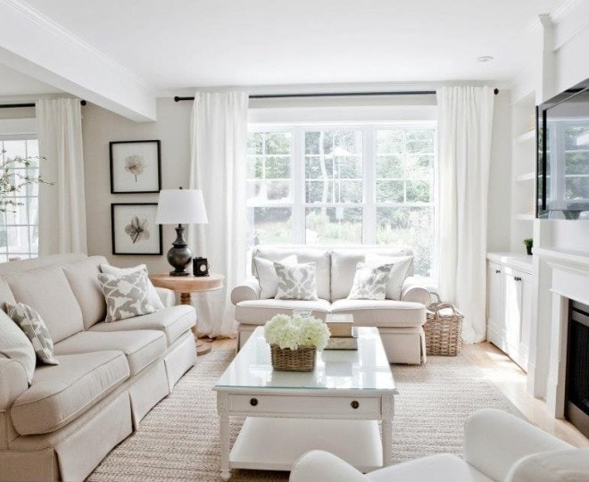 edgcomb gray walls in living room with neutral couch and white curtains