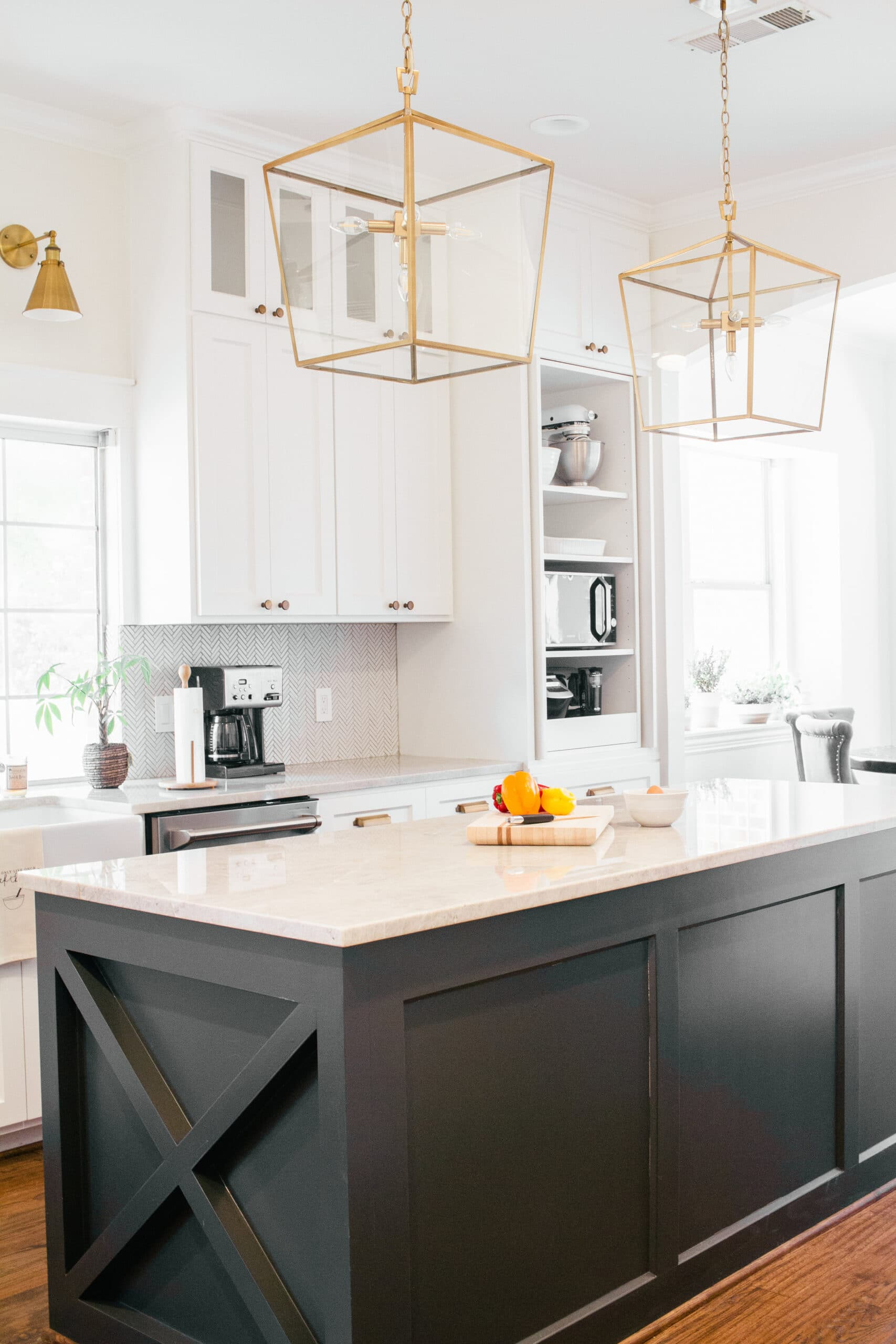 sw iron ore painted kitchen island with pure white cabinets and gold lantern pendants