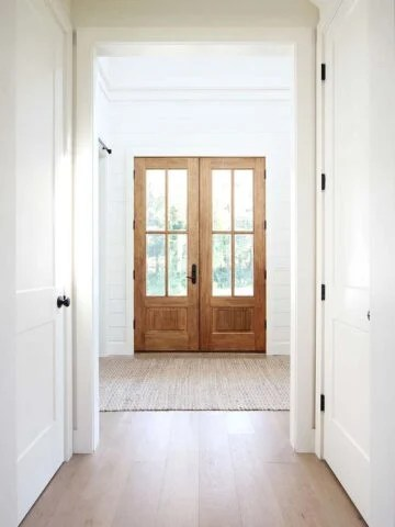 sherwin williams creamy entryway with wooden french doors