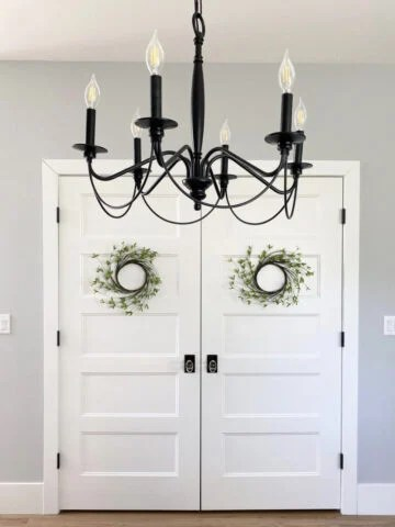 walls painted passive gray with cool white entryway doors