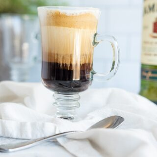 traditional Irish coffee in a glass coffee cup