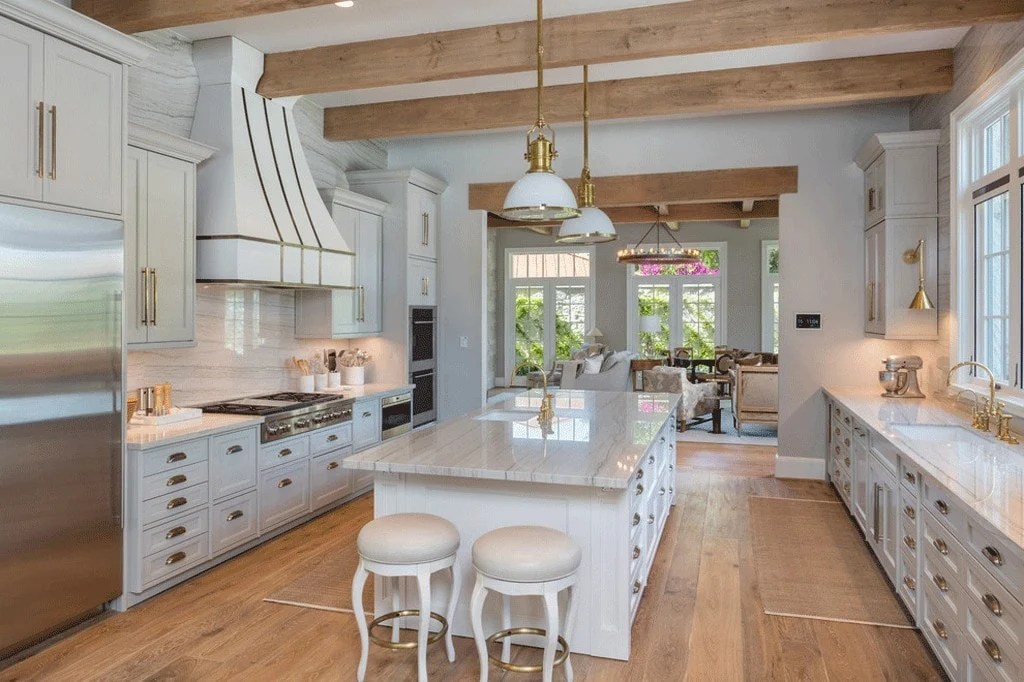 Kitchen with wood beams overhead and cabinets painted Repose Gray