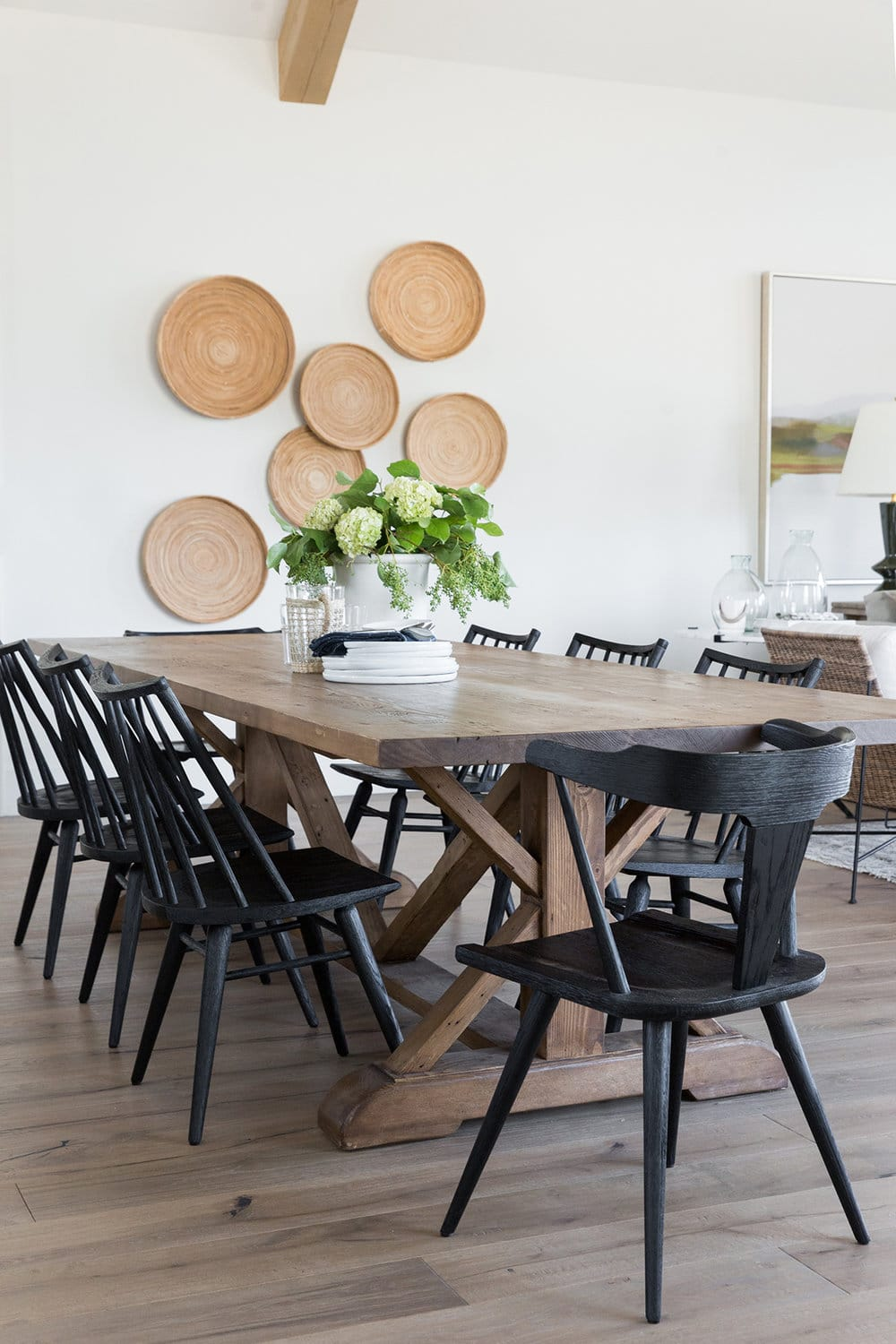 dining space with rattan baskets hanging on the wall