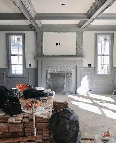 Dark gray contrasting millwork around fireplace