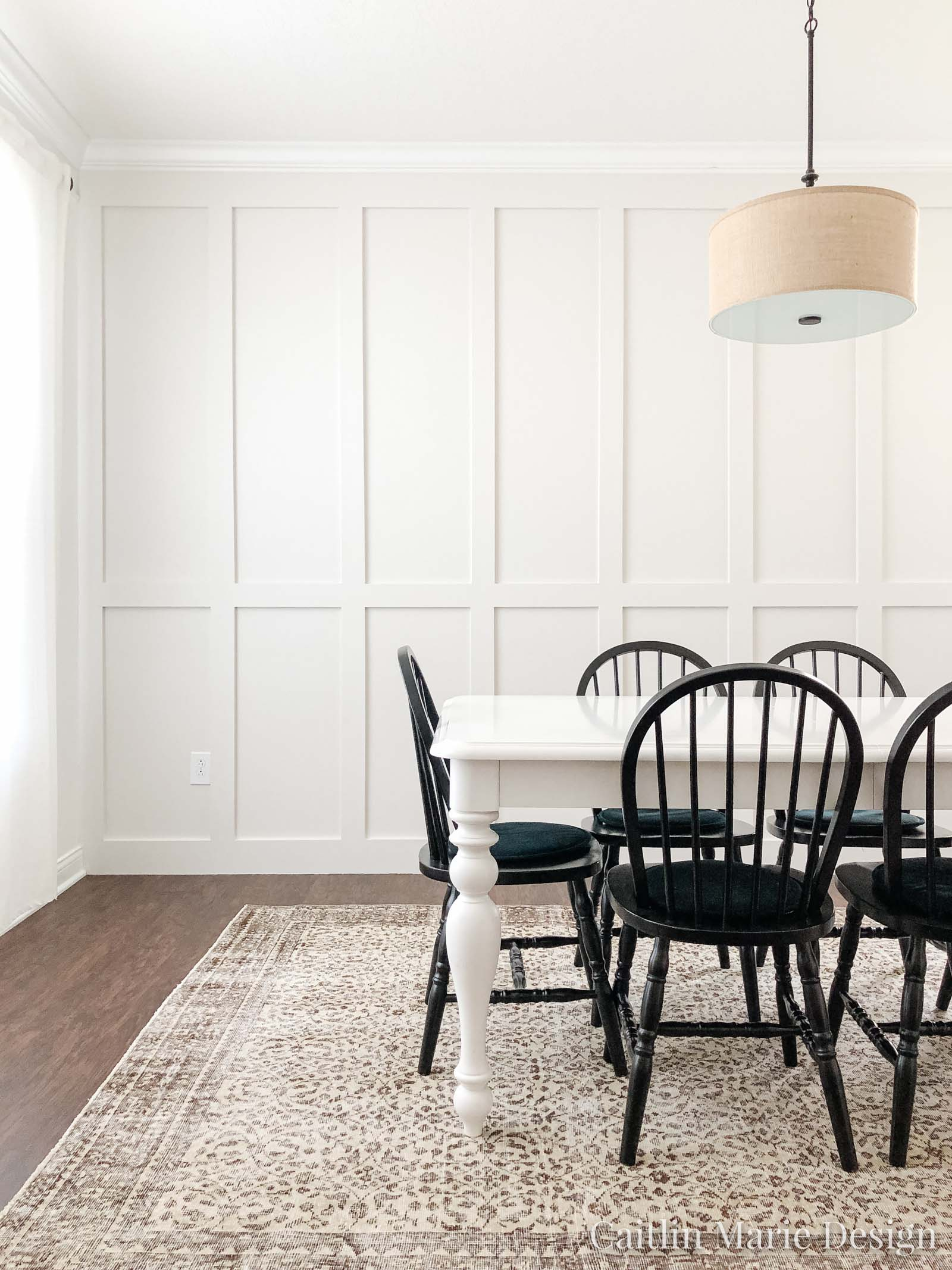 Dining space with beefy floor to ceiling board and batten accent wall