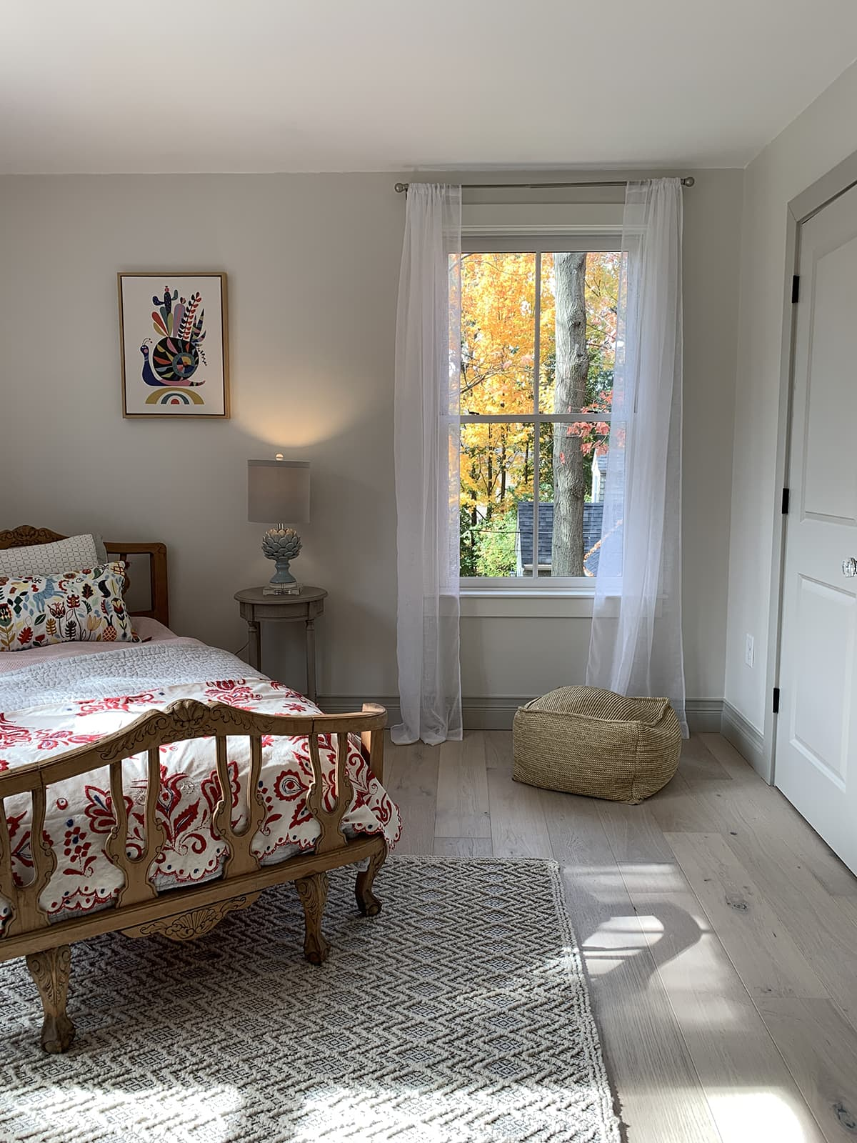 bedroom with darker baseboards and white window trim