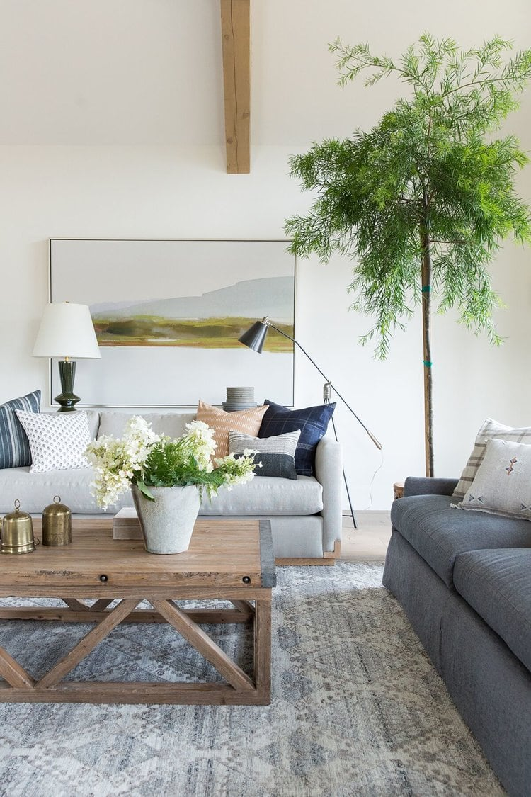 large scale over over a couch in a living room
