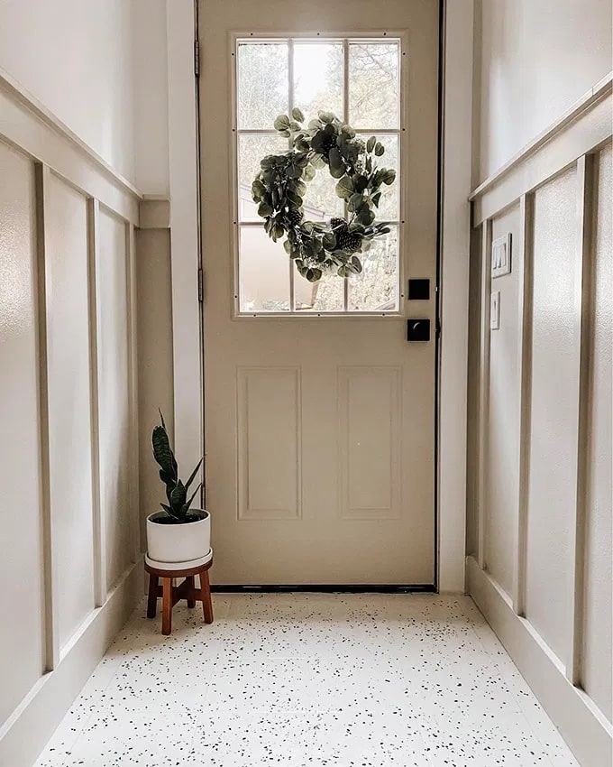 White trim with painted door and contrasting millwork