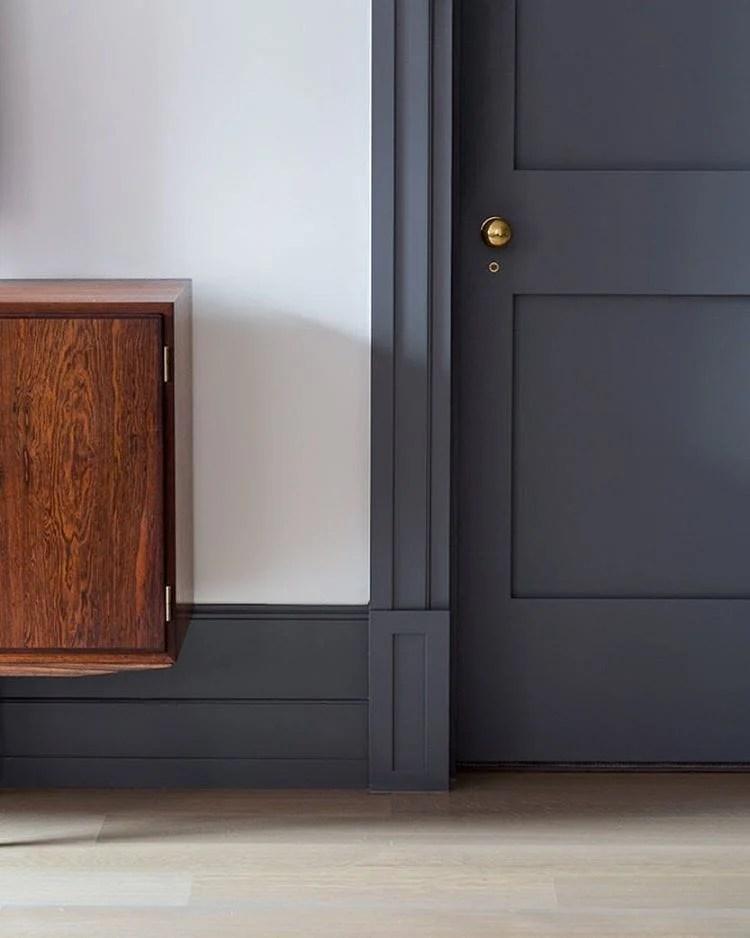 white walls with dark slate gray door and trim