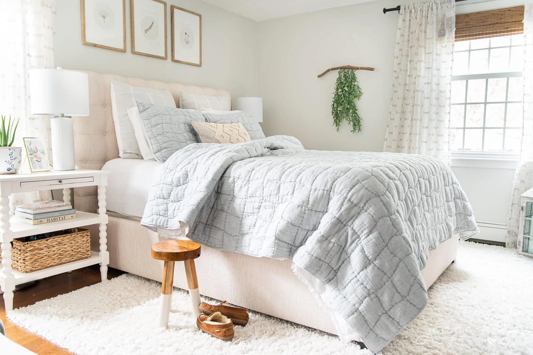 summer bedroom with light blue quilt