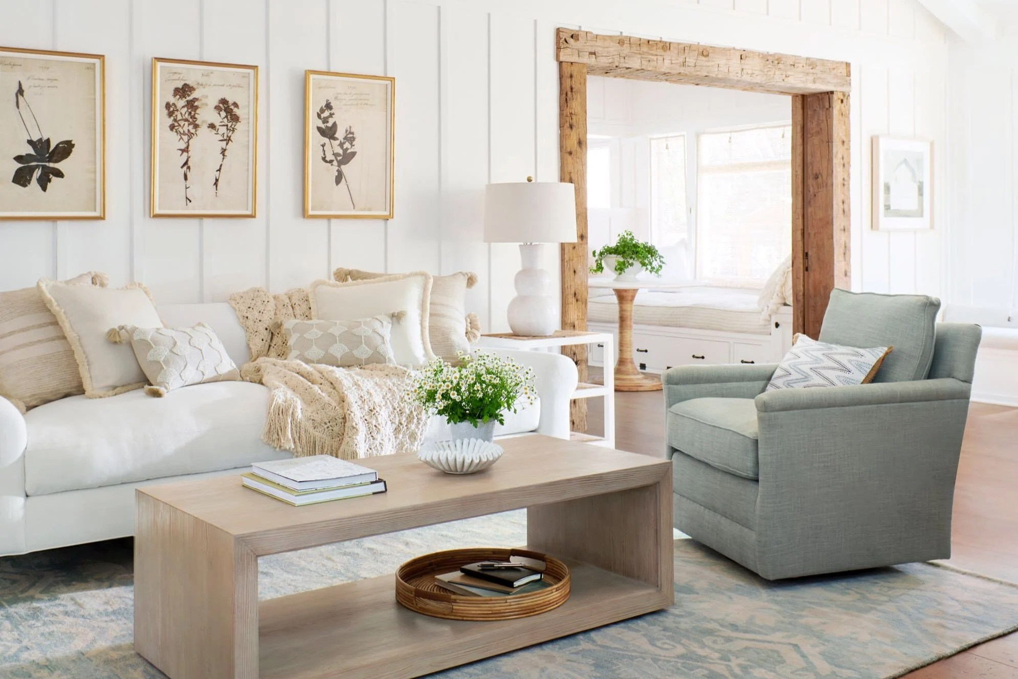 A living room filled with furniture and rustic wood cased opening