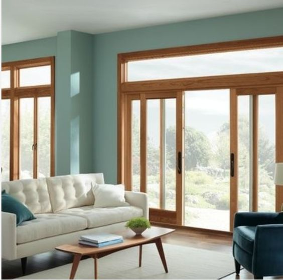 living room with teal walls and honey oak trim