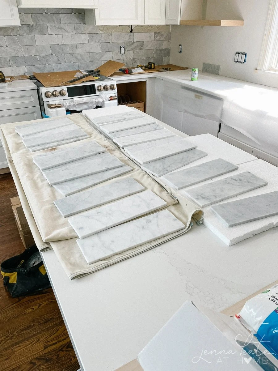 marble tile laid out to be installed on the kitchen wall