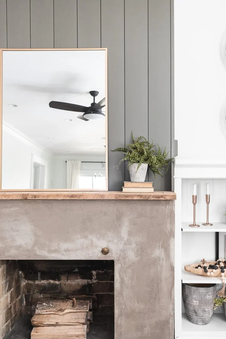 concrete fireplace with rustic mantel