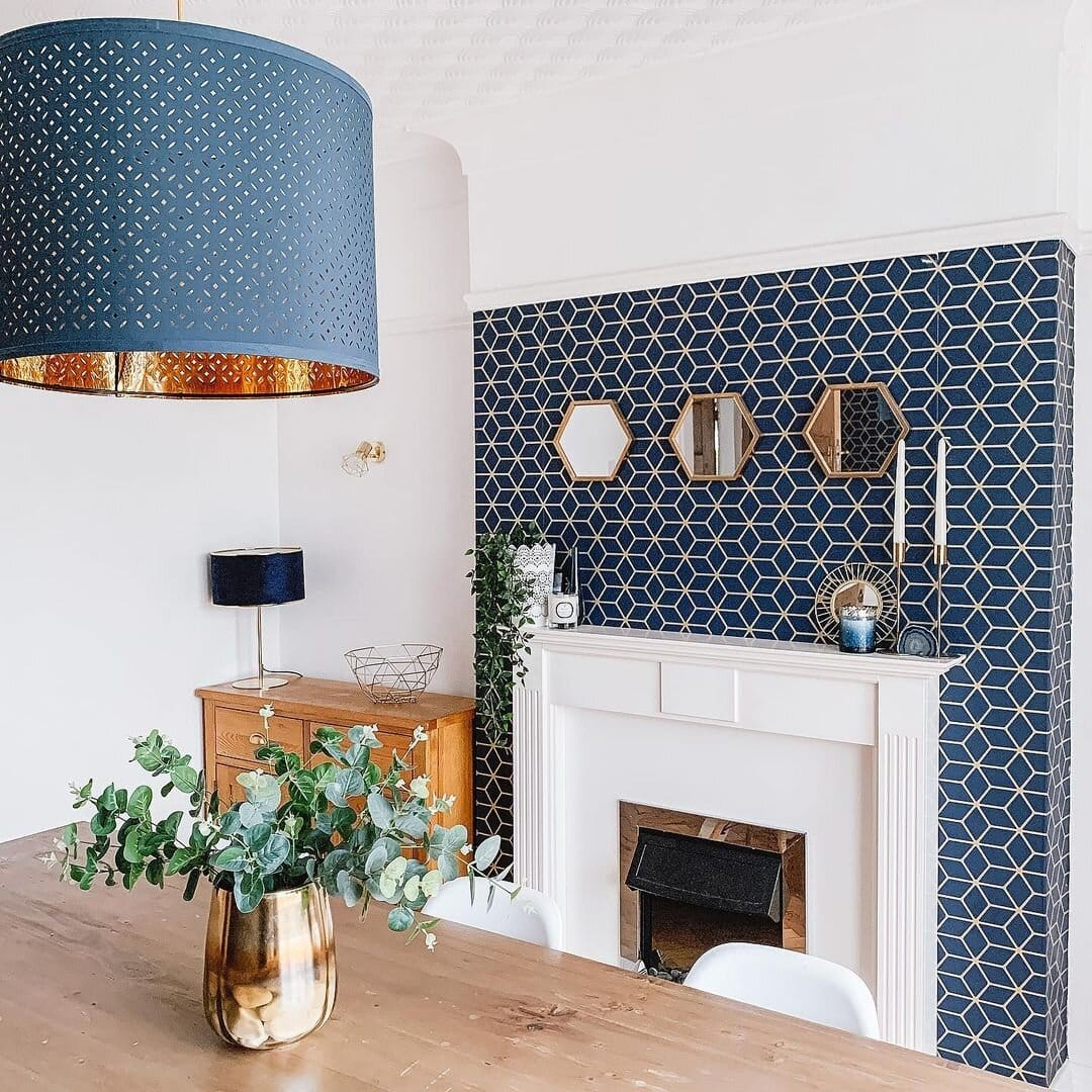 fireplace and wall with decorative wallpaper