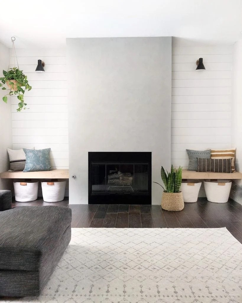 concrete fireplace with shiplap accent wall