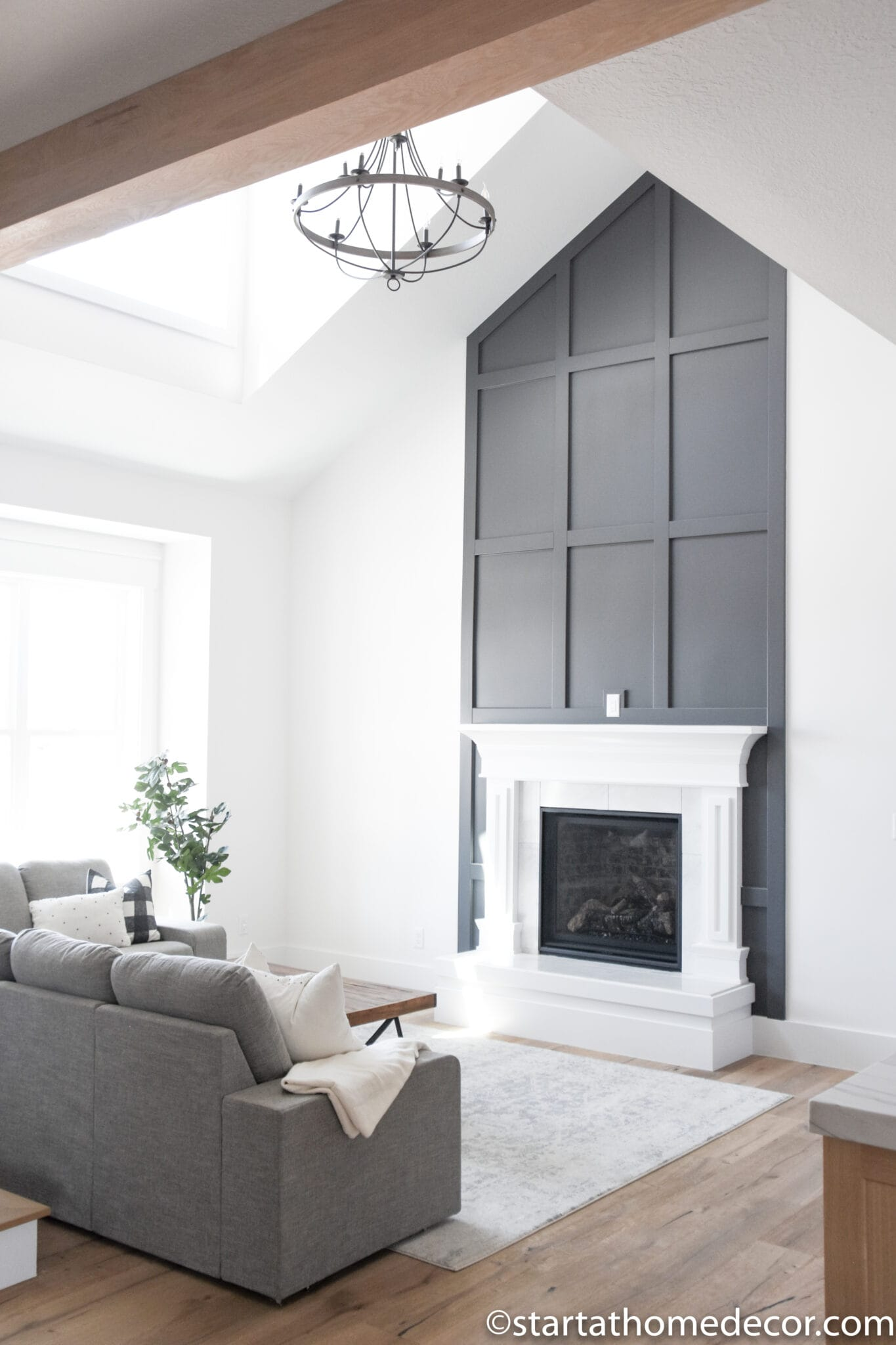 tall geometric millwork behind white fireplace