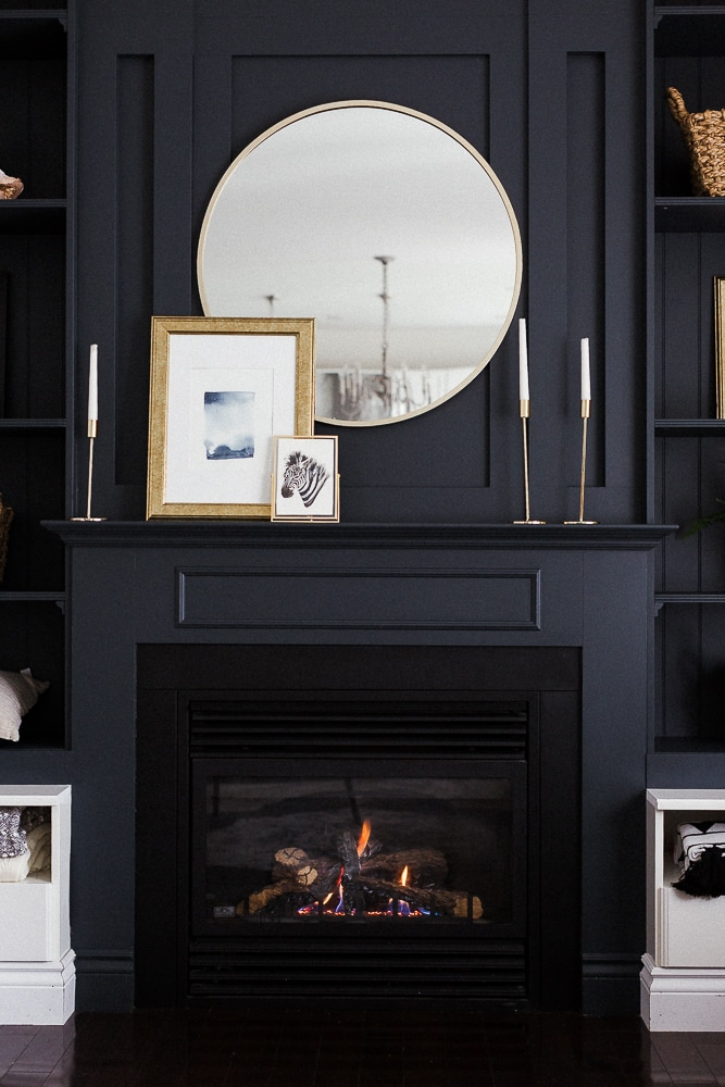 black painted accent wall with fireplace and built-ins
