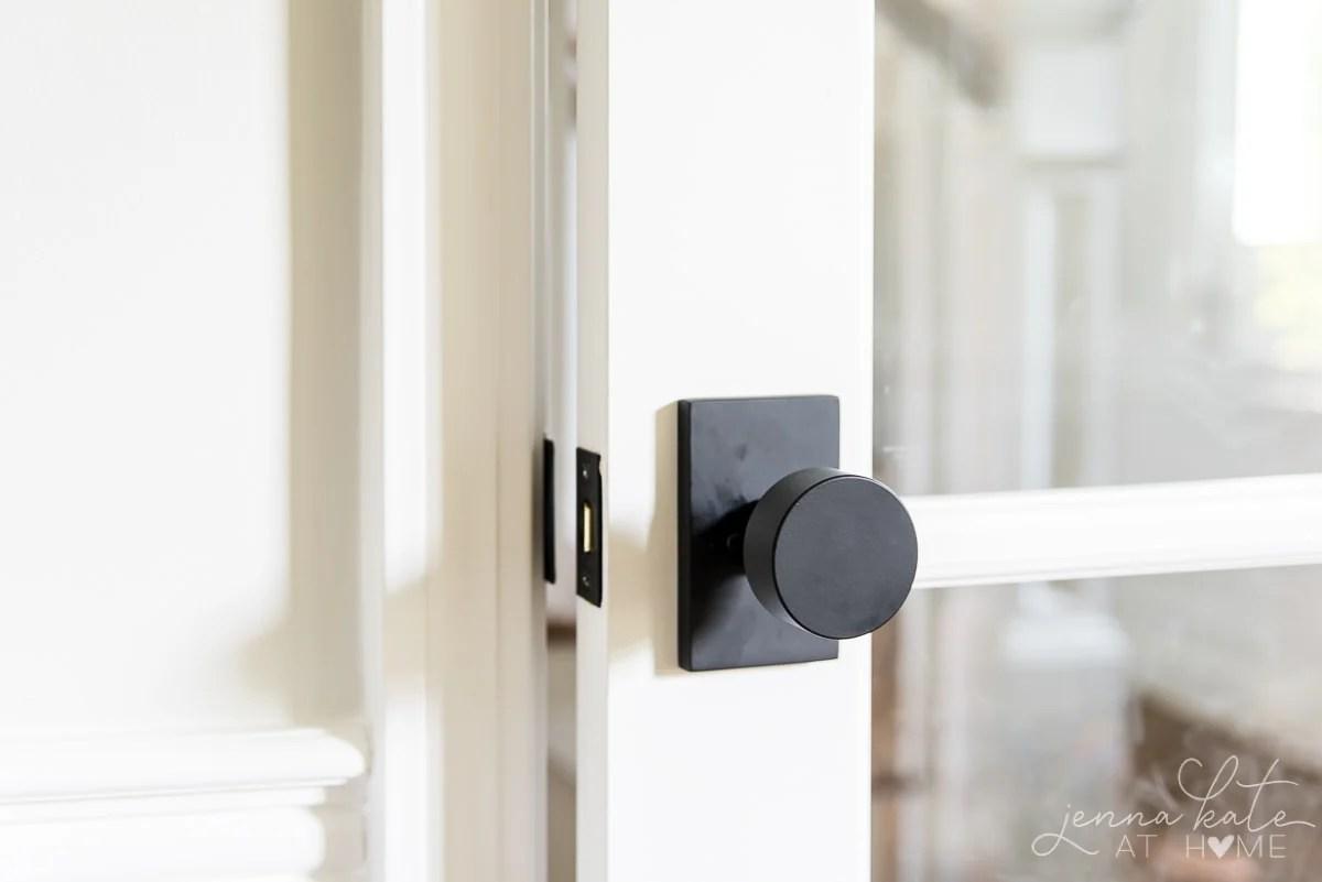 white door with a round black door handle