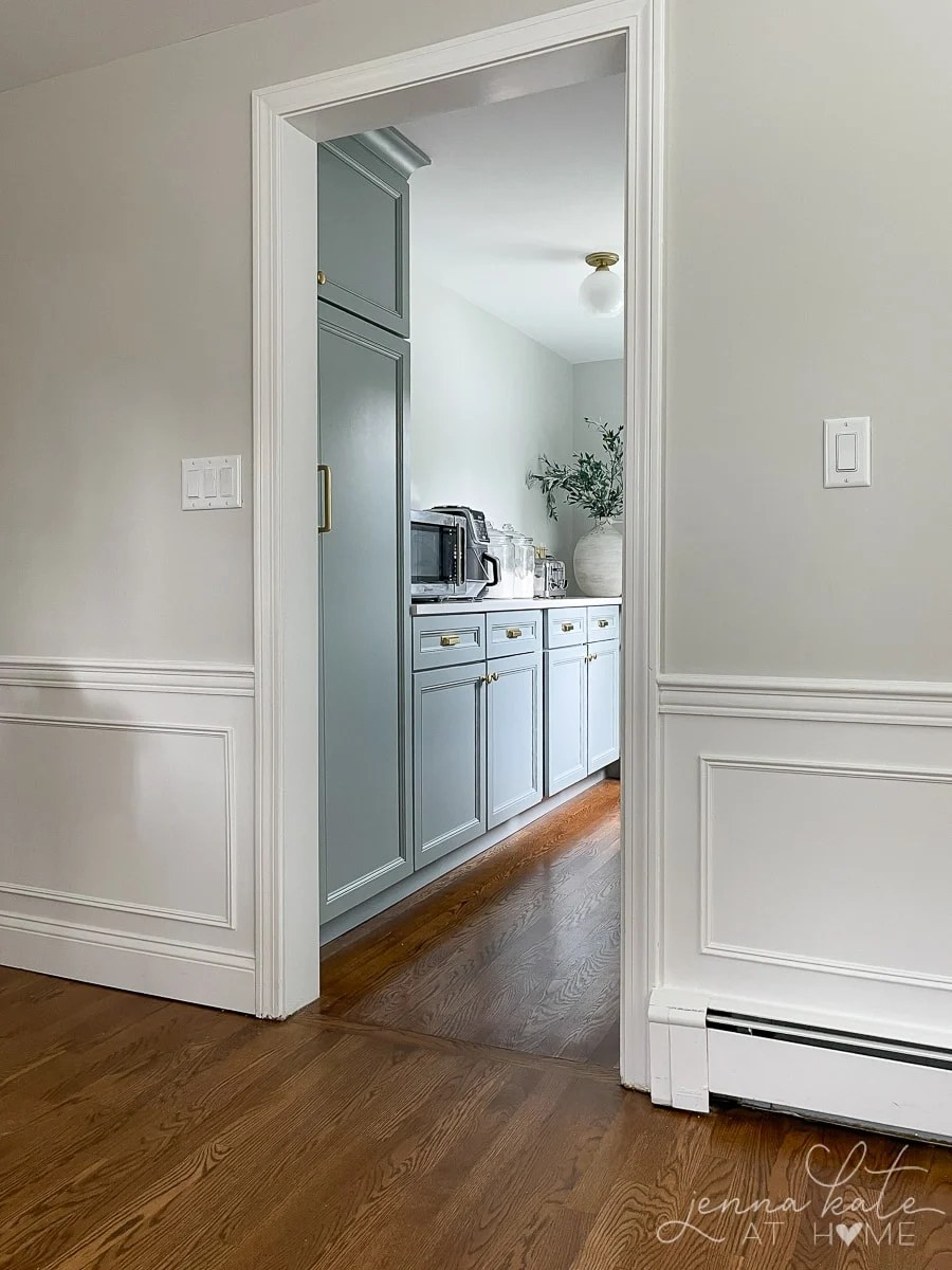 Walk in pantry with blue gray cabinets