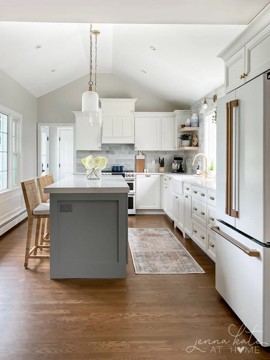 white kitchen with vaulted ceilings and blue-gray center island