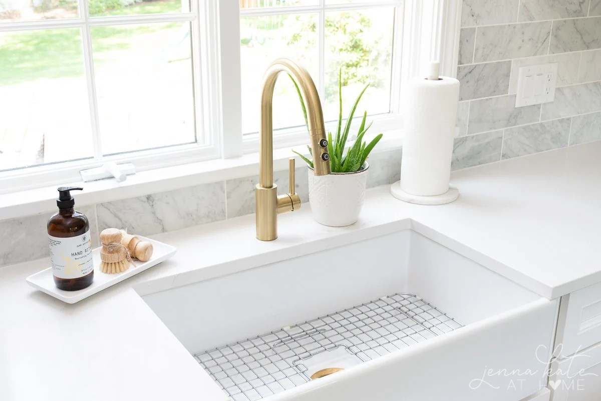 brass faucet and fireclay kitchen sink
