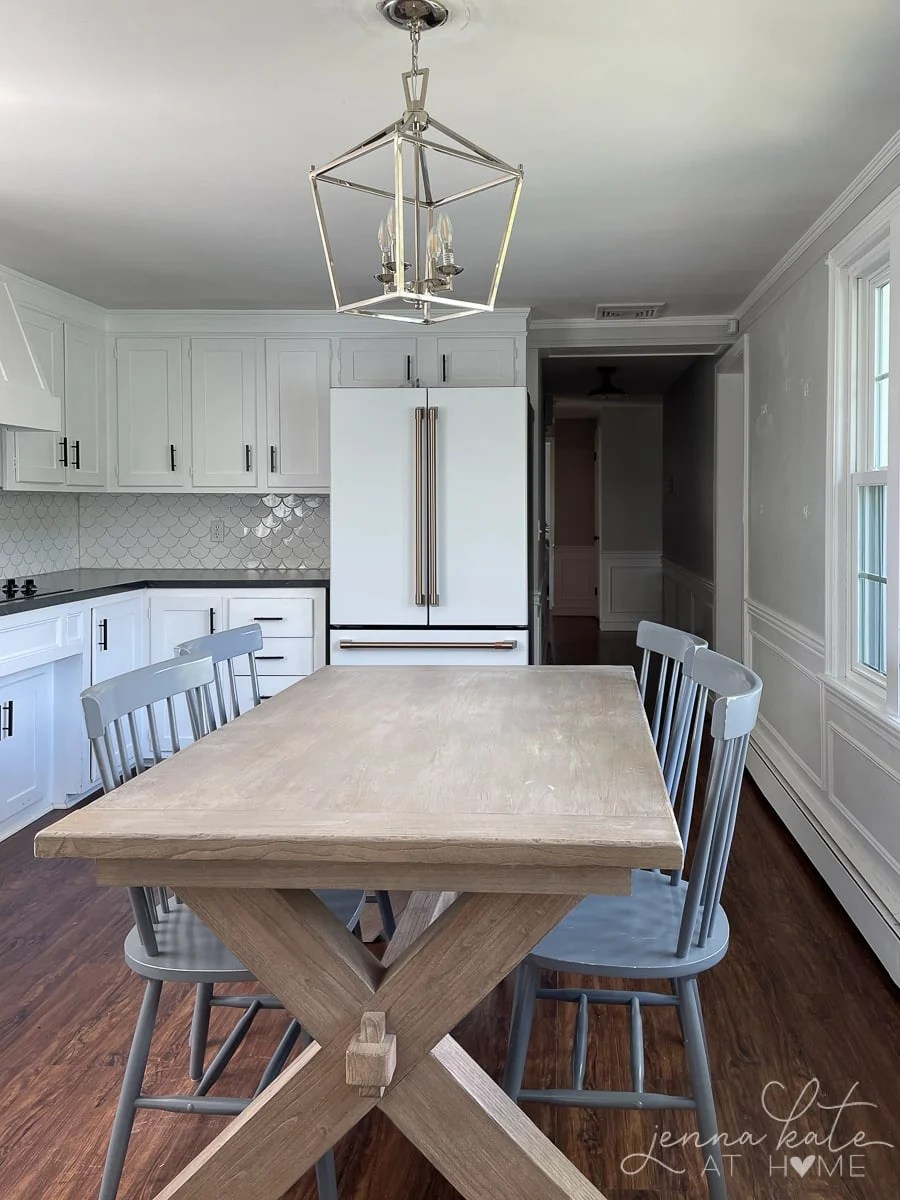 old kitchen with wooden dining table and gray chairs