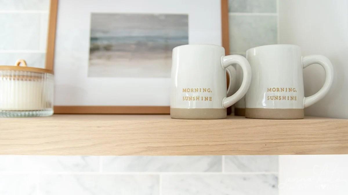 mugs on the kitchen shelf
