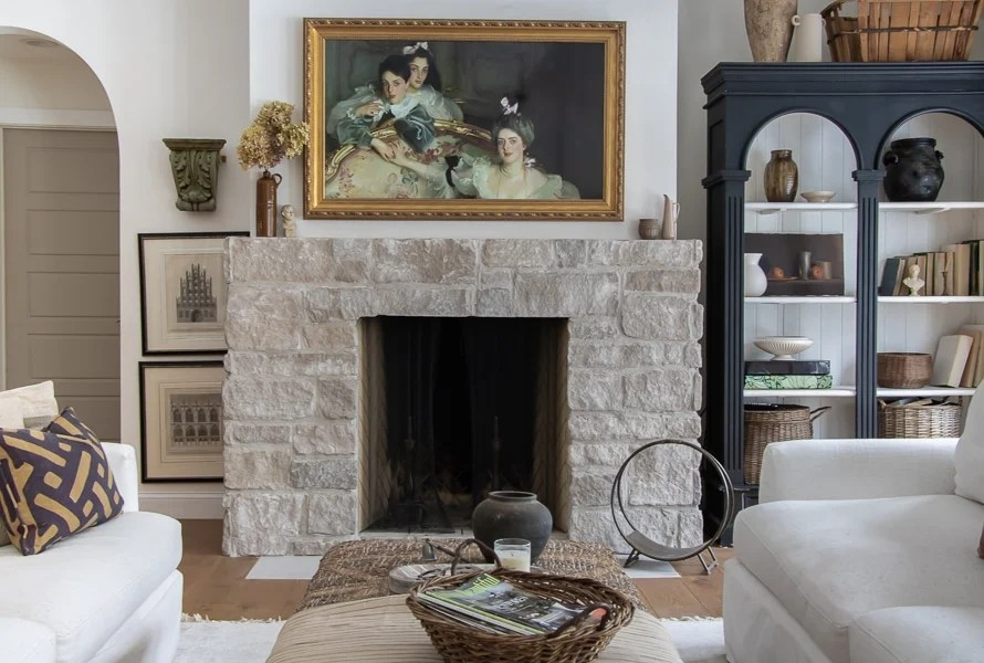brick fireplace with european style art over it