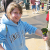 Jessica makes a new lorikeet friend at the Aquarium of the Pacific in Long Beach.