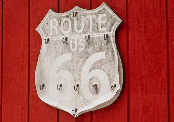 Faded Route 66 sign on red background