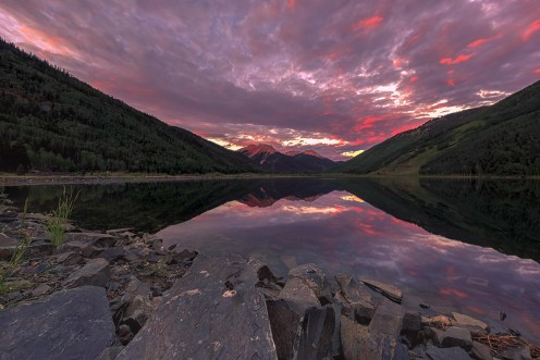 The skies were filled with color above Crystal Lake, for a moment before sunrise before the clouds won the battle.