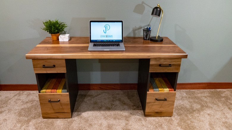 This is a desk we made for a friend using a solid walnut top and wood dyed slats for the shelves.