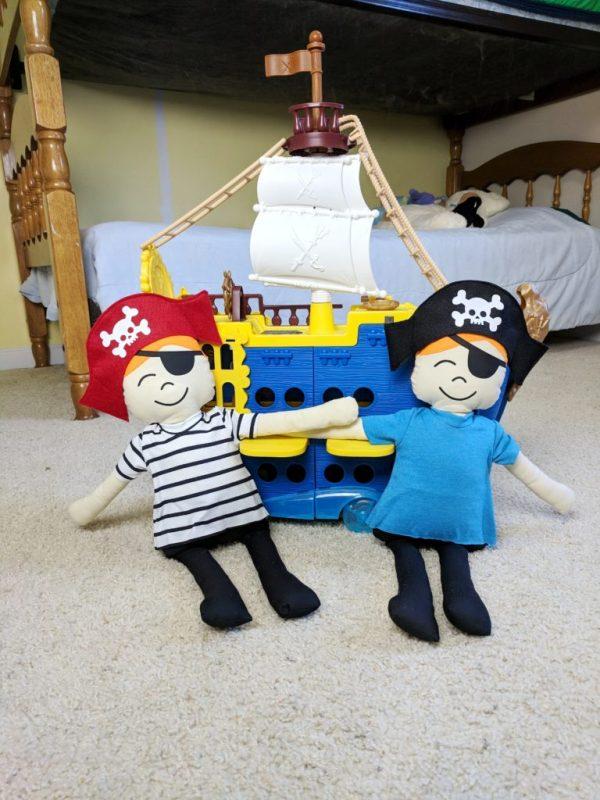 stuffed pirates with a pirate ship