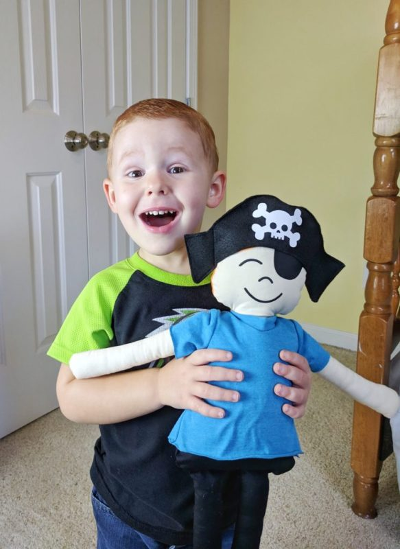 Little boy with stuffed pirate
