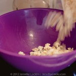 Start with fresh popped corn and pour it into a large microwave safe bowl.