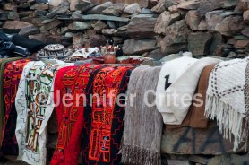 Throws, runners, shawls and sweaters, many made of llama, guanaco or sheep wool, are for sale at roadside stops.