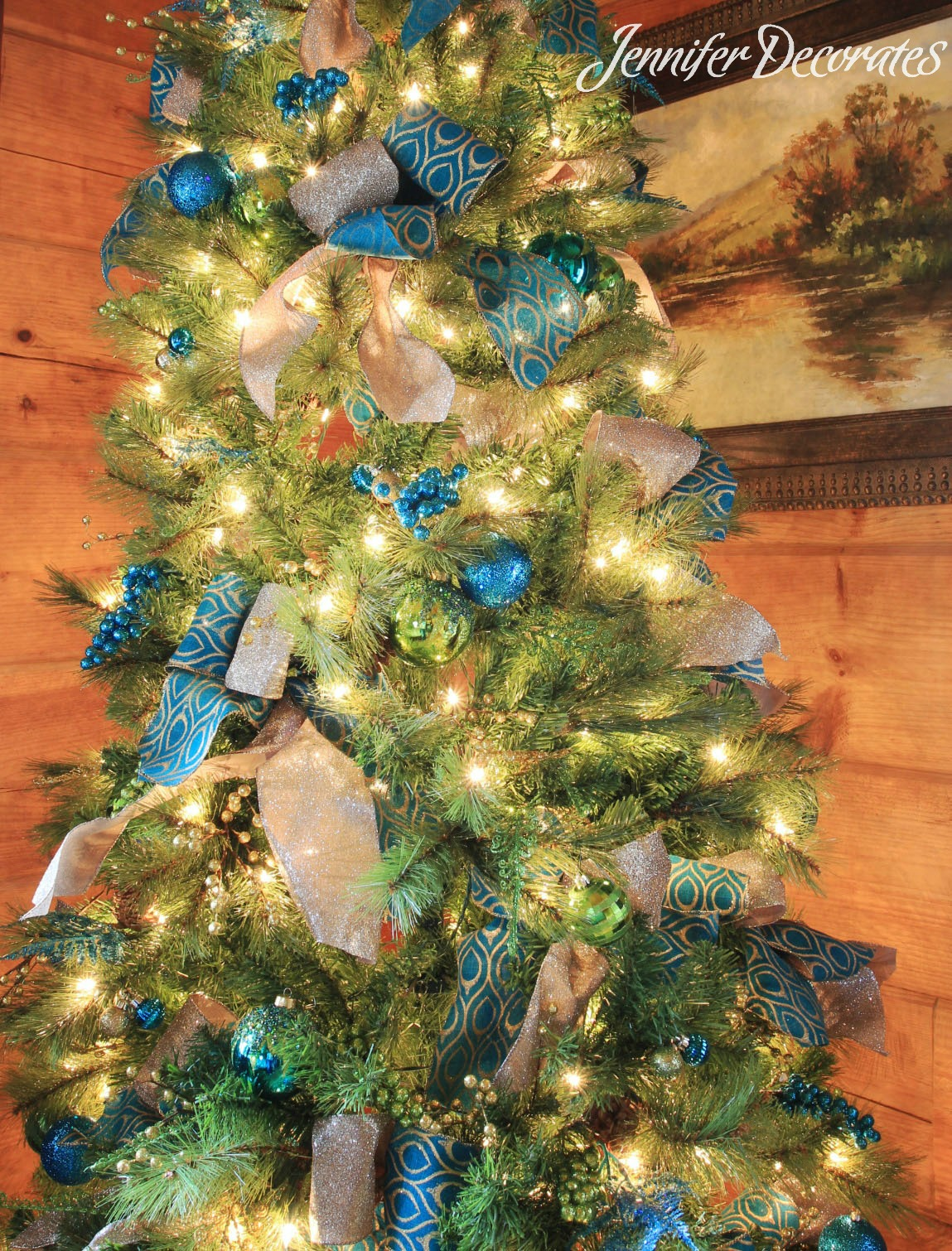 i have never used teal blue in my own christmas decorating but i love how this christmas tree turned out the main colors are teal green and gold