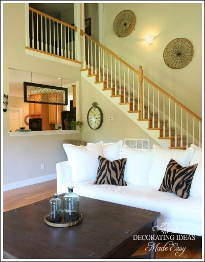 We hung two large round rattan baskets going up the stairs. When you have  high ceilings, don't be afraid to decorate high on the walls.