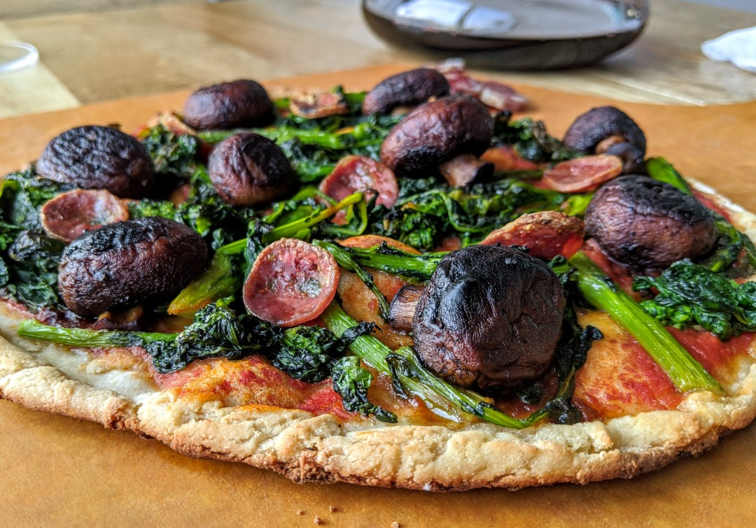 gluten free sausage and rapini pizza