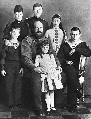 Grand Duke Michael, Marie, Tsarevich Nicholas, Grand Duchess Xenia, Grand Duke George, and Alexander III holding Grand Duchess Olga