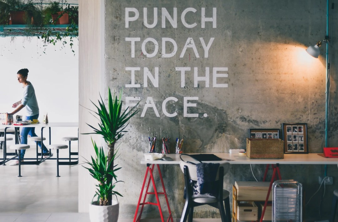"A sign on a wall reads ""punch today in the face."" This concept is discussed in trauma therapy in Dallas, TX with Rethink Therapy."