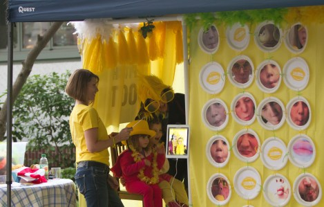 "A family takes a picture in the ""pitcher booth"" at 9.11 LemonAid event in River Forest."