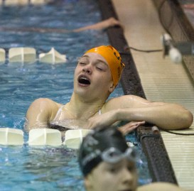 OPRF junior Hanna Blankemeier breathes a sigh of relief after checking her finish time in the 100-yard freestyle at the IHSA Girls Sectionals on Saturday, Nov. 14, 2015.