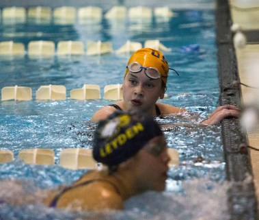OPRF freshman Elizabeth Silber looks at her time after finishing first in her heat of the 500-yard freestyle at the IHSA Girls Sectionals on Saturday, Nov. 14, 2015.