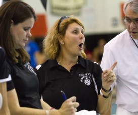 In this Nov. 14, 2015 photo, Fenwick high school girls' swim coach Renee Miller talks with a IHSA referee during the IHSA Girls Sectional at Fenwick High School.